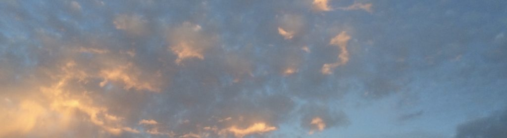 A group of clouds in the sky Description automatically generated